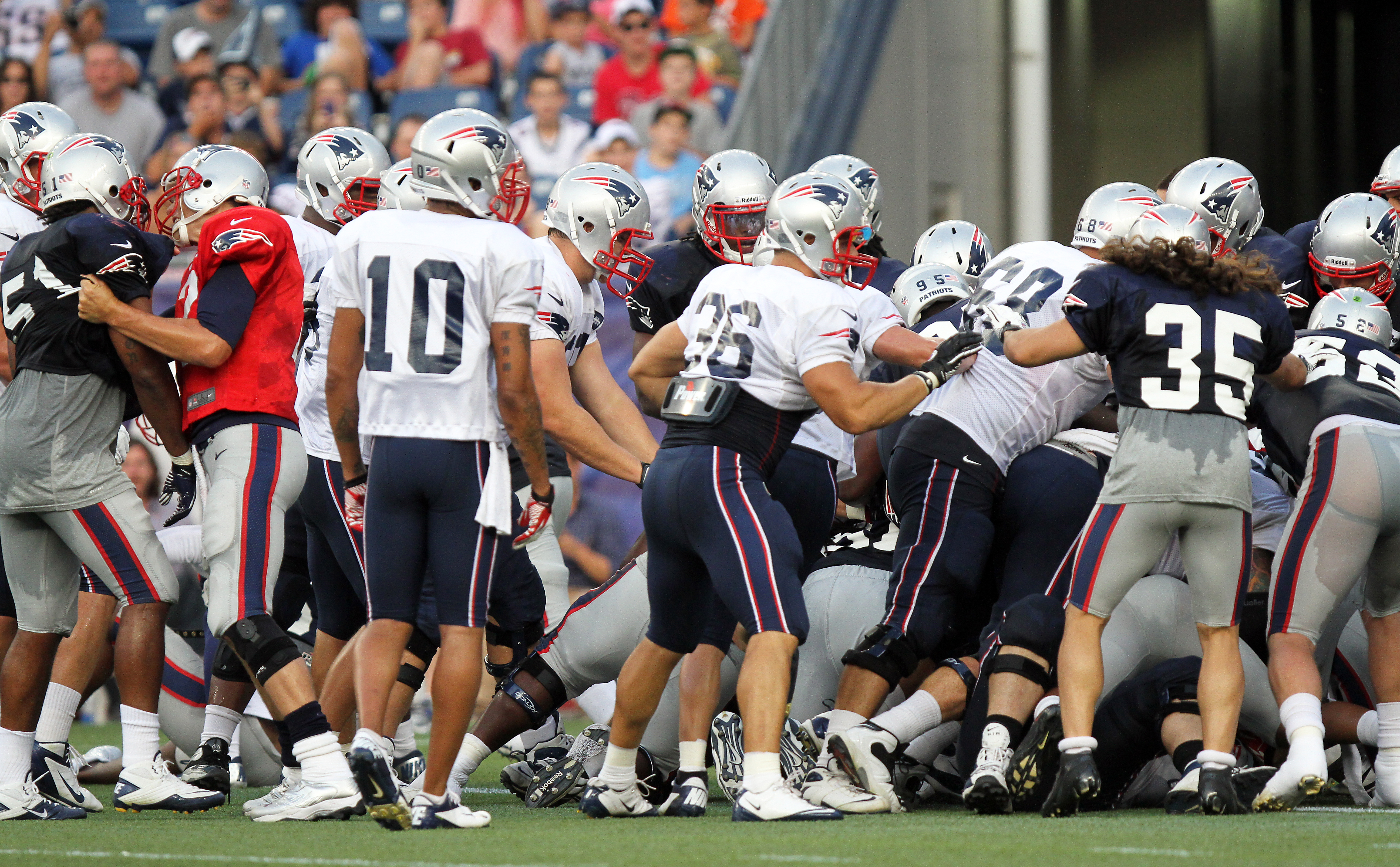 d4d62d1e 1, 2012: New England Patriots wide receiver Wes Welker catches a ball from  quarterback Tom Brady during the Patriots' training camp practice in  Gillette ...